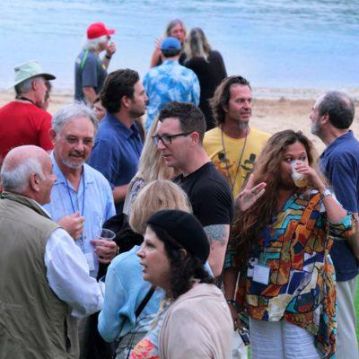 Participants mingling with faculty at Kalapaki beach